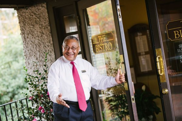 Biltmore employee holding open door and smiling