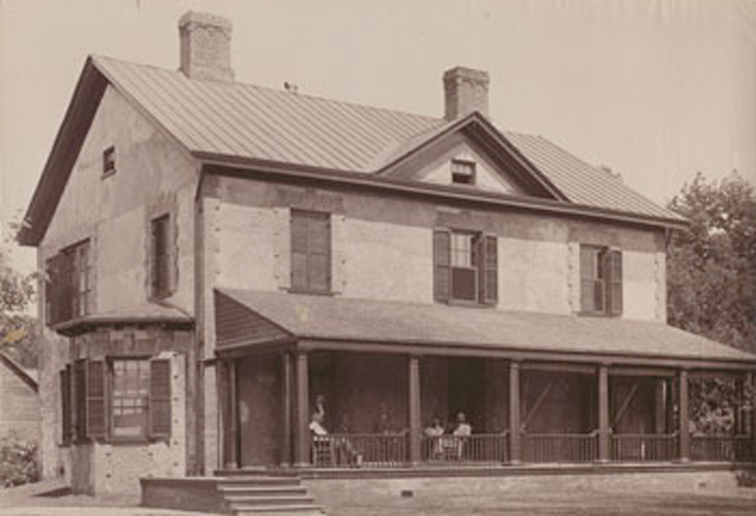 Archival image of the Brick Farm House, circa 1889
